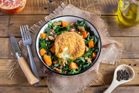 Kale salad, roasted sweet potato, pomegranate, and breaded Saint Marcellin cheese